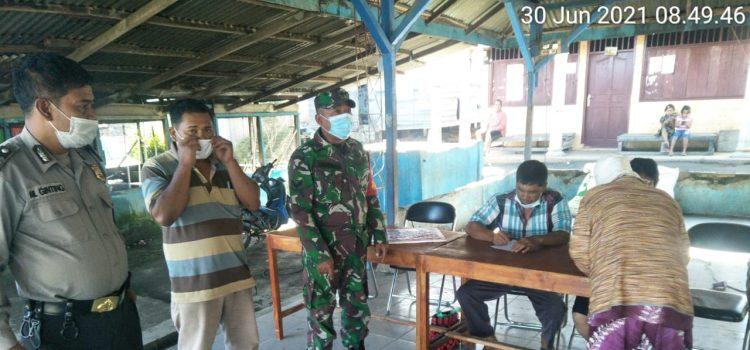 Personel Koramio 06/MT Laksanakan PAM Pembagian BLT di Desa Biak Nampe
