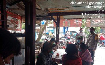 Anggota Koramil 07/JH Himbau Pengunjung dan Pemilik Warung Kopi Patuhi Prokes