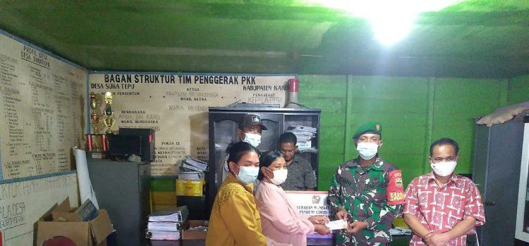 Babinsa Koramil 04/SE Dampingi Penyerahan BLT 3 Tahap Kepada Warga Desa Sukatepu