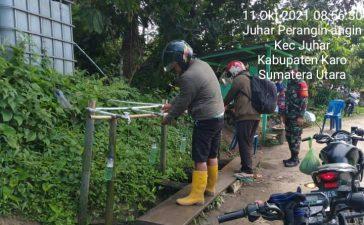 Babinsa Koramil 07/JH Awasi dan Himbau Masyarakat yang Akan Memasuki Desa Juhar Perangin Angin Patuhi Prokes